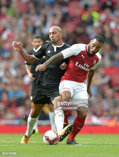 Sevilla's Steven N'Zonzi vies with Arsenal's French striker Alexandre Lacazette during the preseason friendly football match between Arsenal and...