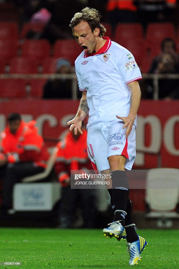 Sevilla's Swiss midfielder Ivan Rakitic reacts during the Copa del Rey (King's Cup) semi-final second leg football match Sevilla FC vs Atletico de Madrid at the Ramon Sanchez Pizjuan staduim in Sevilla on February 27, 2013.