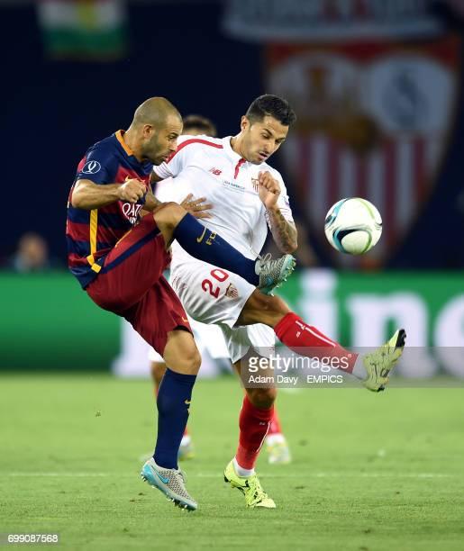 Sevilla's Vitolo and Barcelona's Javier Mascherano battle for the ball