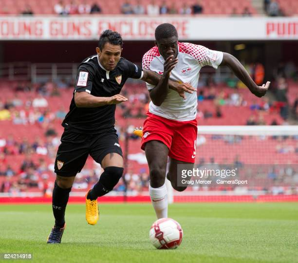 Sevilla's Walter Montoya vies for possession with RB Leipzig's Dayot Upamecano during the Emirates Cup match between RB Leipzig and Sevilla FC at...