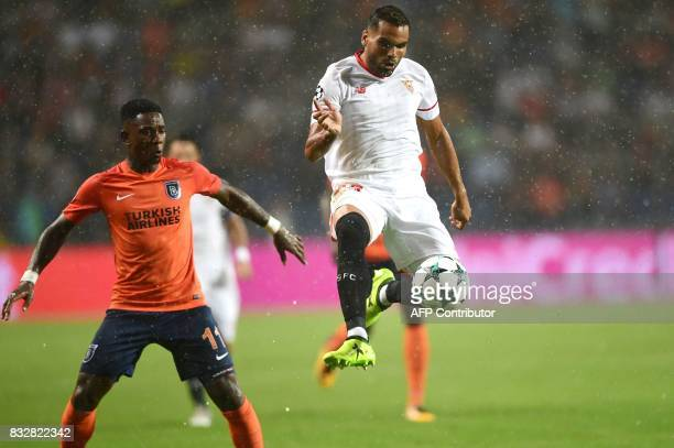 Sevilla's Walter Montoya vies for the ball with Basaksehir's Eljero Elia during the UEFA Champions League playoff first leg football match between...