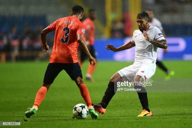 Sevilla's Walter Montoya vies for the ball with Basaksehir's Gael Clichy during the UEFA Champions League playoff first leg football match between...
