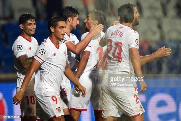Sevilla's Wissam Ben Yedder celebrates with his teammates after scoring a goal during the UEFA Champions League playoff first leg football match...