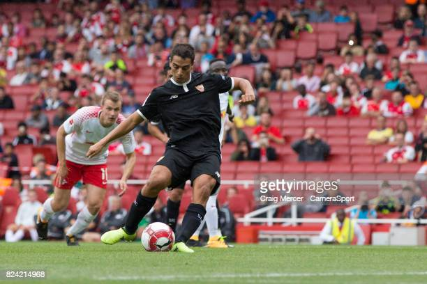 Sevilla's Wissam Ben Yedder scores the opening goal from the penalty spot during the Emirates Cup match between RB Leipzig and Sevilla FC at Emirates...