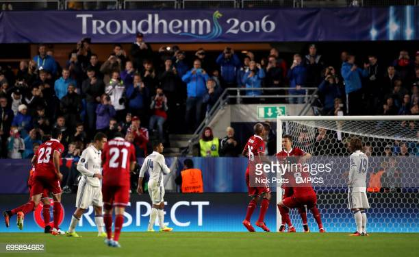 Sevilla's Yevhen Konoplyanka is mobbed by his teammates after scoring from the penalty spot