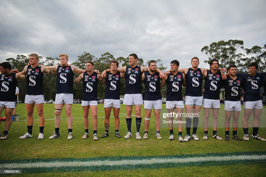 Seville players stand for the Australian national anthem before the start of the the Yarra Valley Mountain District Football League Division 2 Seniors Grand Final between Healesville and Seville at Yarra Junction Football Ground on September 14, 2013 in Melbourne, Australia.
