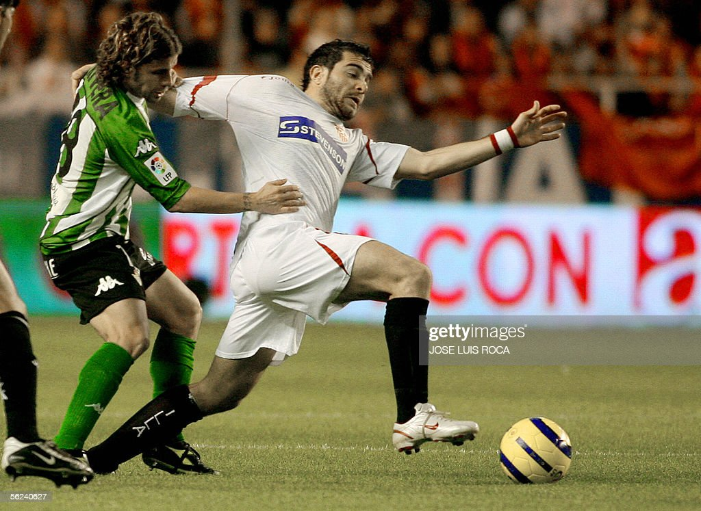 Betis's player Rivera vies with Sevilla's player Maresca in a match of the Spanish League at the Ramon Sanchez Pizjuan stadium in Seville 19 November...