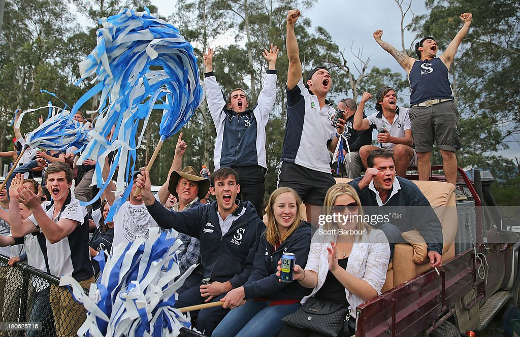 Seville supporters sitting on a couch on the back of a ute celebrate after their team kicked a goal during the Yarra Valley Mountain District Football League Division 2 Seniors Grand Final between Healesville and Seville at Yarra Junction Football Ground on September 14, 2013 in Melbourne, Australia.