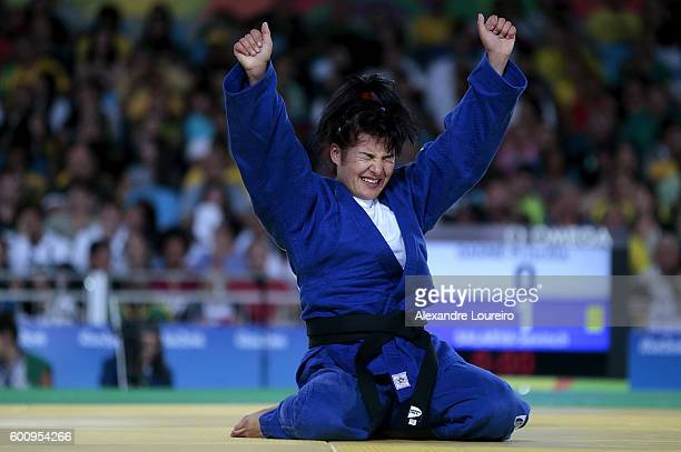 Sevinch Salaeva of Uzbekistan celebrates the victory against Priscilla Gagne of Canada during the women's 52 kg bronze medal match on Day 1 of the...