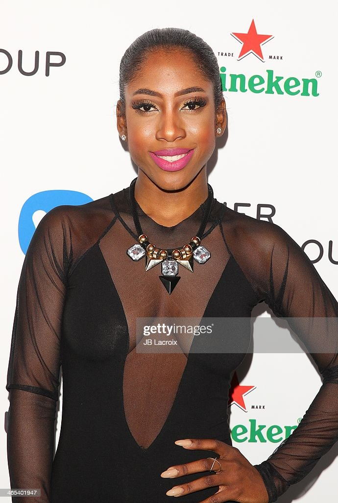 <a gi-track='captionPersonalityLinkClicked' href=/galleries/search?phrase=Sevyn+Streeter&family=editorial&specificpeople=10081619 ng-click='$event.stopPropagation()'>Sevyn Streeter</a> attends the Warner Music Group Hosts Annual Grammy Celebration held at Sunset Tower on January 26, 2014 in West Hollywood, California.