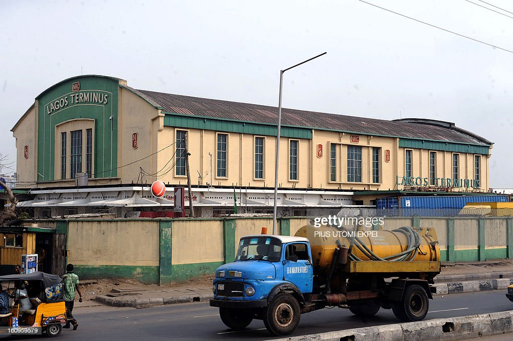 A sewage truck drive past the Lagos Terminus of the Nigerian Railway Corporation on February 8, 2013. The rejuvenated Nigerian Railway Corporation has commenced operation of mass transit on the Lagos-Kano route, Nigeria's major commercial cities. The state-owned corporation which went into bankruptcy during the last 20 years due to lack of maintenance of infrastructure and high numbers of employees also began haulage of petroleum products from Lagos to the north of the country. Earlier last year, the Railway Corporation had acquired 20 pressurised tank wagons as it prepared to commence the fuel haulage. The 20 wagons have the capacity to lift 900,000 litres of petroleum products, the equivalent of 27 road tankers. AFP PHOTO/PIUS UTOMI EKPEI