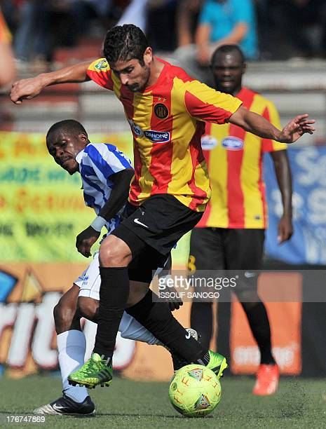 Sewe Sport de San Pedro's Kako Rostan vies with Esperance Tunis' Etraoui during the African Champions league football match Sewe Sport de SanPedro vs...