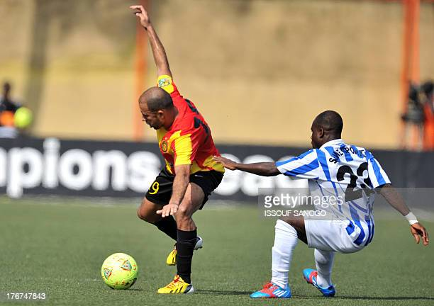 Sewe Sport de San Pedro's Kevin Zougoula fights for the ball with Esperance Tunis'Khaled during the African Champions league football match Sewe...