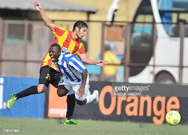 Sewe Sport de San Pedro's Ocansey Mandela vies with Esperance Tunis' Medji Traoui during the African Champions league football match Sewe Sport de...