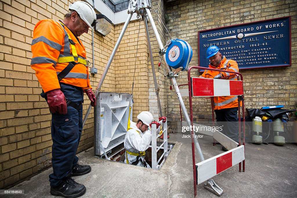 Sewer technician Craig White (C) descends into the Northern Outfall Sewer at Wick Lane depot on May 25, 2016 in London, England. The sewer was designed by British engineer Joseph Bazalgette following the 'Great Stink' of 1858 and is today worked on by sewer technicians known as 'Flushers'. Thames Water marks Sewage Week this week with a series of events inviting members of the public down into the underground sewer network and around the Abbey Mills pumping station in east London.