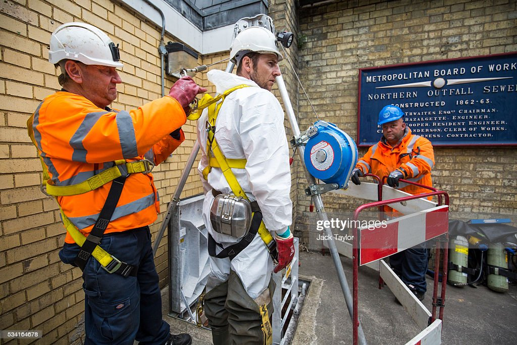 Sewer technician Craig White (C) prepares to descend into the Northern Outfall Sewer at Wick Lane depot on May 25, 2016 in London, England. The sewer was designed by British engineer Joseph Bazalgette following the 'Great Stink' of 1858 and is today worked on by sewer technicians known as 'Flushers'. Thames Water marks Sewage Week this week with a series of events inviting members of the public down into the underground sewer network and around the Abbey Mills pumping station in east London.