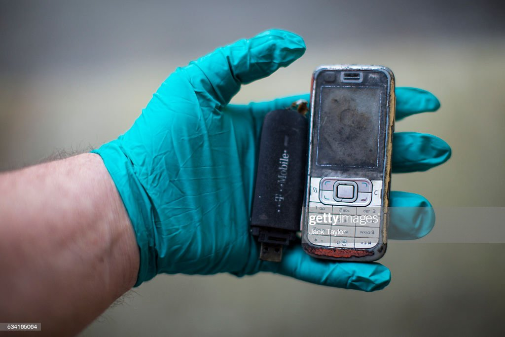 A sewer technician displays a phone and dongle fished out of the Northern Outfall Sewer at Wick Lane depot on May 25, 2016 in London, England. The sewer was designed by British engineer Joseph Bazalgette following the 'Great Stink' of 1858 and is today worked on by sewer technicians known as 'Flushers'. Thames Water marks Sewage Week this week with a series of events inviting members of the public down into the underground sewer network and around the Abbey Mills pumping station in east London.