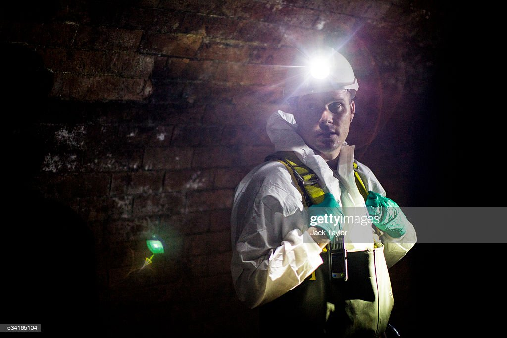 Sewer technician Gari Pattison pictured in the Northern Outfall Sewer at Wick Lane depot on May 25, 2016 in London, England. The sewer was designed by British engineer Joseph Bazalgette following the 'Great Stink' of 1858 and is today worked on by sewer technicians known as 'Flushers'. Thames Water marks Sewage Week this week with a series of events inviting members of the public down into the underground sewer network and around the Abbey Mills pumping station in east London.