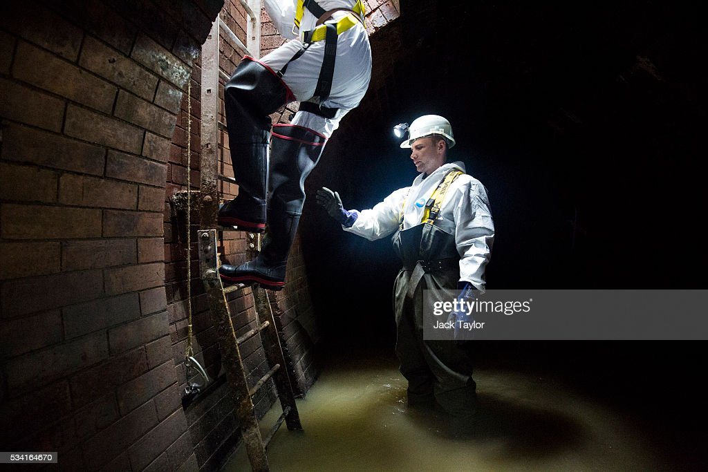Sewer worker Harry Calder helps lower a visitor into the Northern Outfall Sewer at Wick Lane depot on May 25, 2016 in London, England. The sewer was designed by British engineer Joseph Bazalgette following the 'Great Stink' of 1858 and is today worked on by sewer technicians known as 'Flushers'. Thames Water marks Sewage Week this week with a series of events inviting members of the public down into the underground sewer network and around the Abbey Mills pumping station in east London.