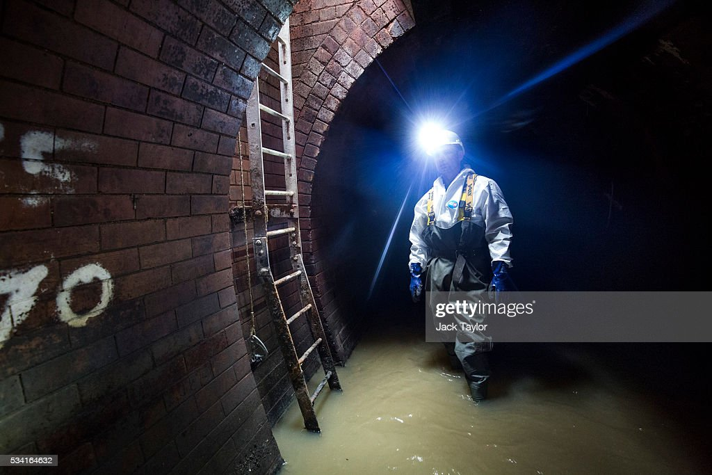 Sewer worker Harry Calder pictured in the Northern Outfall Sewer at Wick Lane depot on May 25, 2016 in London, England. The sewer was designed by British engineer Joseph Bazalgette following the 'Great Stink' of 1858 and is today worked on by sewer technicians known as 'Flushers'. Thames Water marks Sewage Week this week with a series of events inviting members of the public down into the underground sewer network and around the Abbey Mills pumping station in east London.