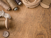Buttons, threads and needle on a tailor's table