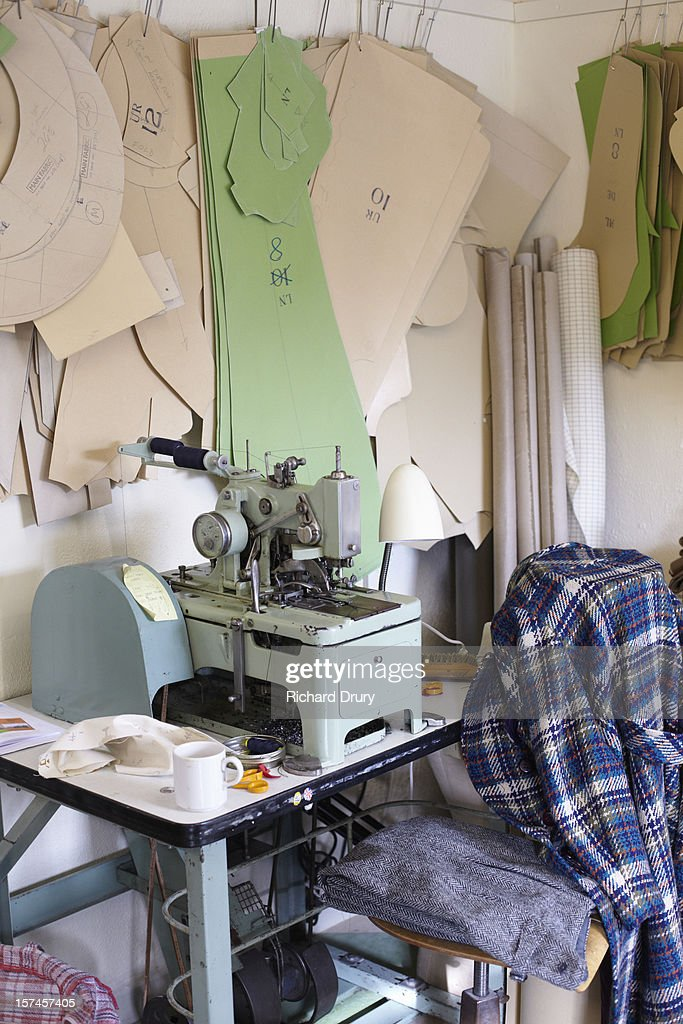 Sewing machine in clothing manufacturers workshop : Stock Photo