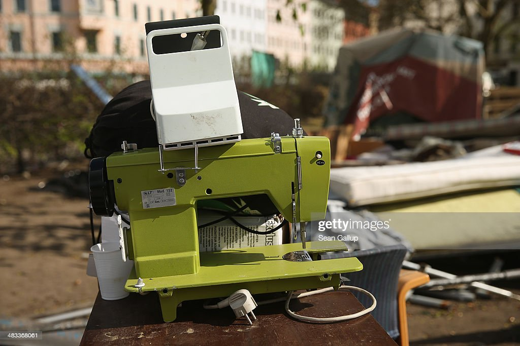 A sewing machine is among detritus remaining at the former temporary refugee camp at Oranienplatz in Kreuzberg district after riot police sealed it off on April 8, 2014 in Berlin, Germany. Several hundred riot police sealed off the square after, according to an eyewitness, violence broke out between refugees who had accepted a deal by the city to leave the camp and a small number who insisted on staying. Refugees, many of them from Africa who came to Germany via Lampedusa, began dismantling their shelters today after many of them agreed to a deal with city authorities to move to a renovated hostel. Not all of the several hundred refugees, some of whom have been living at the Oranienplatz camp almost a year, have agreed to the deal, and while some said they will go elsewhere, some insisted they will stay, despite a city order to vacate.