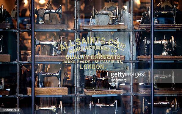 Sewing machines are displayed in the window of AllSaints Retail Ltd store at the Third Street Promenade outdoor mall in Santa Monica California US on...
