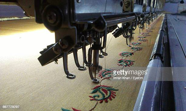 Sewing Machines Over Fabric At Factory