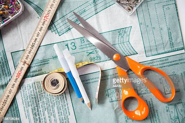 Sewing patter, scissors and tape measure, still life