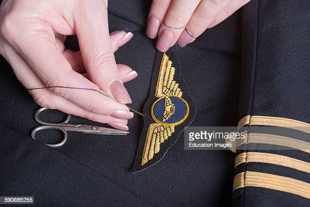 Sewing wings onto a uniform jacket