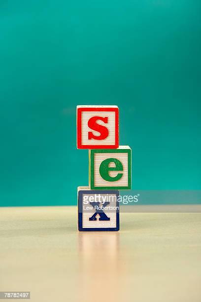 <Sex> Spelled in Alphabet Blocks