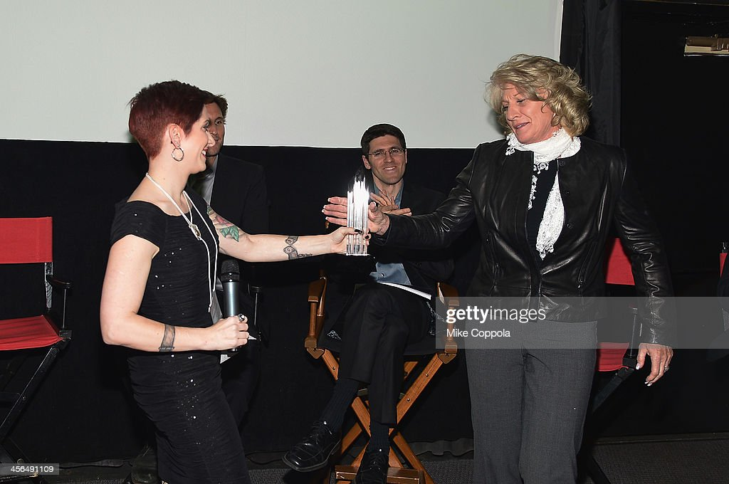Sex trafficking survivor Danielle Douglas hands an award to Las Vegas Metropolitan Police Department Lieutenant Karen Hughes at the premier of...