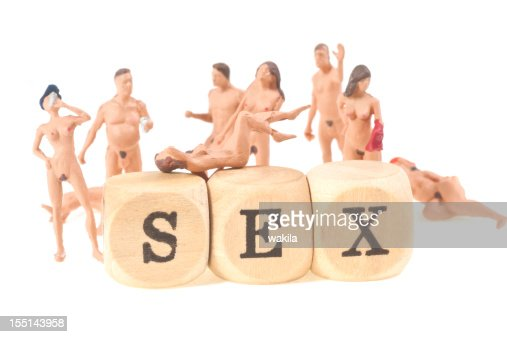 sex word with nude people figurines on white background abstract