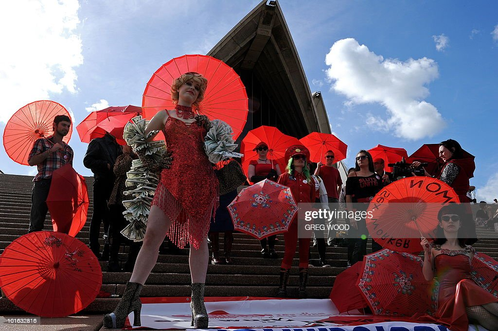 Sex workers and their supporters rally on the steps of the Sydney Opera House to demand legislative anti-discrimination protection for sex workers in Sydney on June 5, 2010. The rally is part of a week of events around International Whores Day, which commemorates the day on June 2, 1975 when a church in Lyon, France, was taken over by sex workers complaining about the lack of action by police when sex workers reported a crime. AFP PHOTO/Greg WOOD