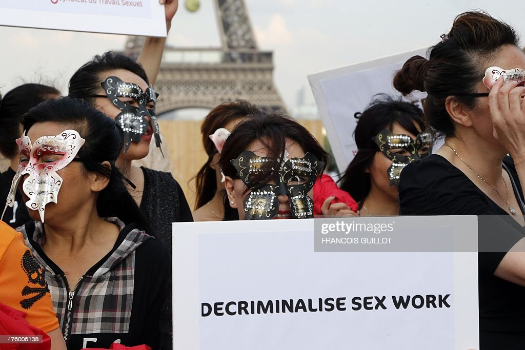 Sex workers take part in a demonstration called by the Strass union and the Roses d'Acier association on June 5 2015 on the Trocadero square in Paris...