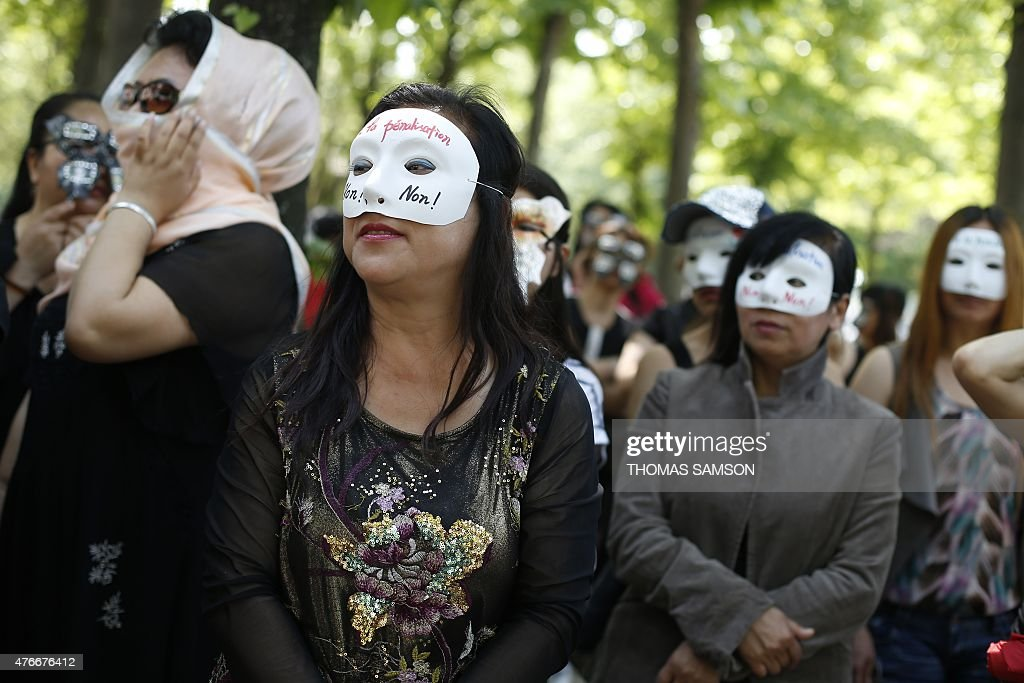 Sex workers take part in a demonstration called by the Strass union and the Roses d'Acier association on June 11 2015 on the Esplanade des Invalides...
