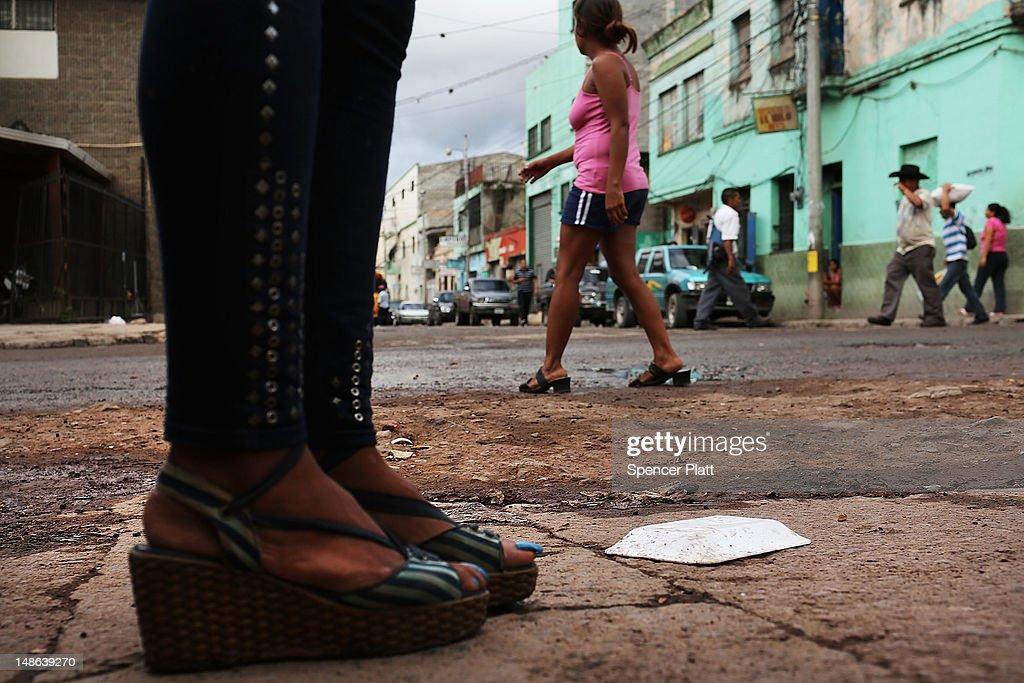 Sex workers wait for customers in a gang infested neighborhood on July 18 2012 in Tegucigalpa Honduras Honduras now has the highest per capita murder...