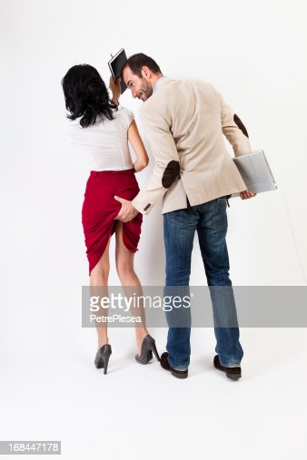 Sexual harassment. Woman hitting the aggresor  with her agenda