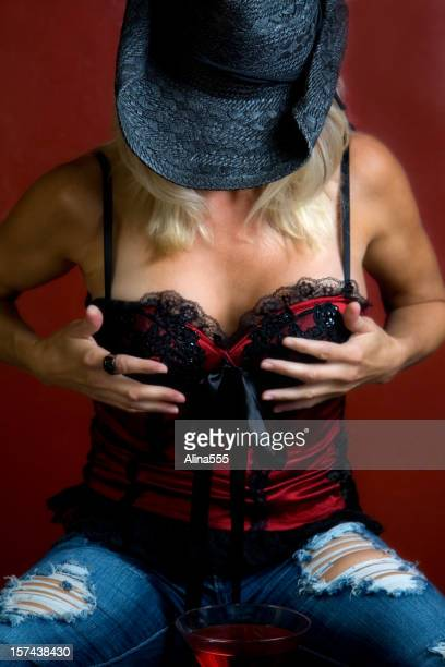 Sexy and beautiful woman with a hat covering her face