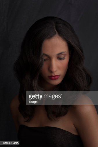 Sexy beauty portrait with woman looking down : Stock Photo