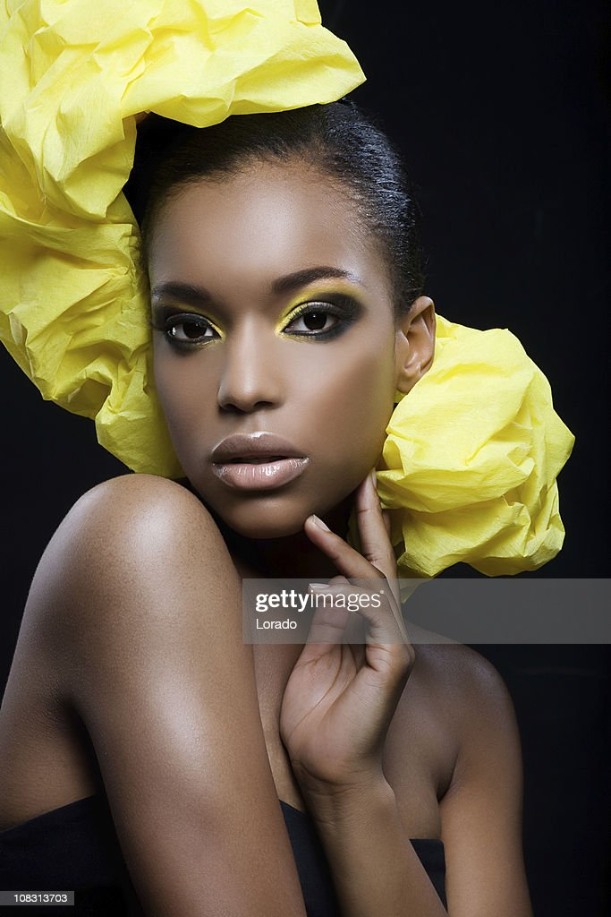 sexy black woman with yellow make-up : Stock Photo