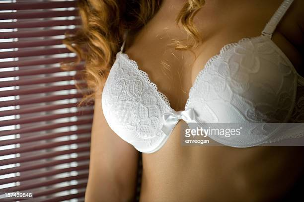 sexy blond in lingerie by a window