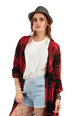 Girl with long auburn, brunette hair with a grunge, punk fashion look displaying a blank t-shirt ready for your design mock-up.