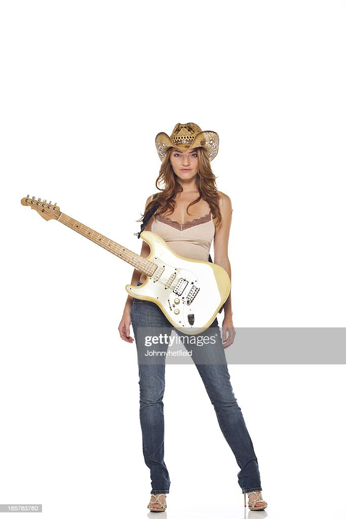 Sexy country girl with her guitar : Stock Photo