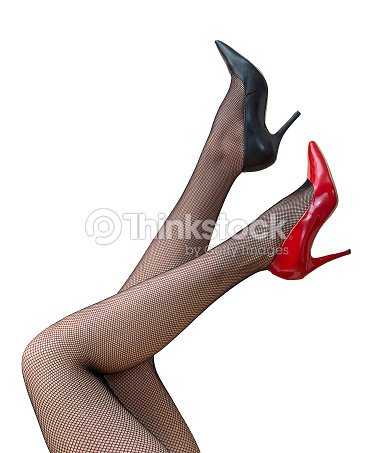 c135561c5d1 Sexy Female Legs In Black Tights Raised Up Stock Photo - Thinkstock