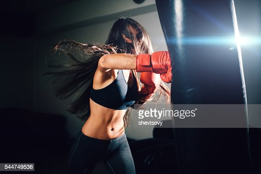 sexy fighter girl punching actively : Stock Photo