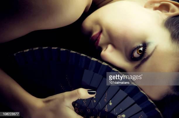 Sexy geisha with fan