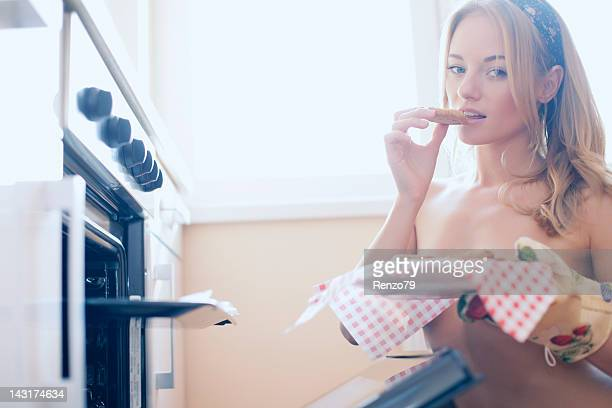 sexy girl baking in kitchen
