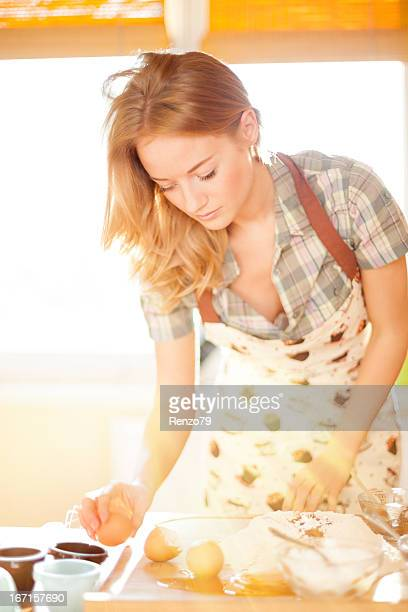 Sexy girl baking in the kitchen